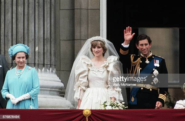 Prince Charles looks happy and his new bride, Lady Diana, The Princess of Wales, looks radiant following their royal wedding in London. They stand on...