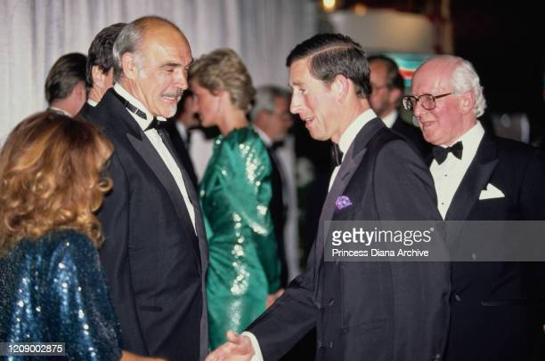 Prince Charles meets actor Sean Connery and his wife Micheline at the premiere of the film 'The Hunt For Red October' in London April 1990 Diana...