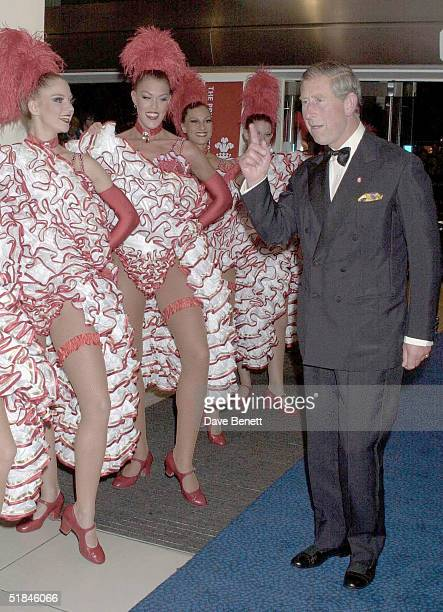 Prince Charles meets Can Can dancers at the premiere of 'Moulin Rouge' in London on September 3 2001 in London