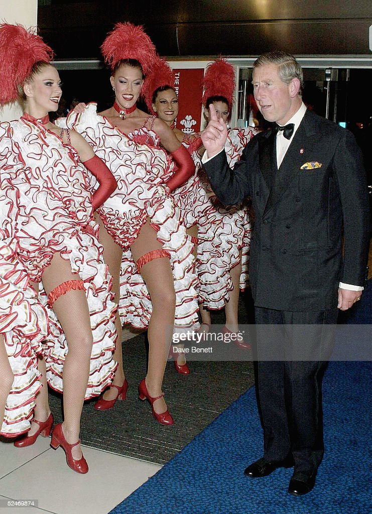 Prince Charles meets Can Can dancers at the premiere of 'Moulin Rouge' in Leicester Square on September 3, 2001 in London.