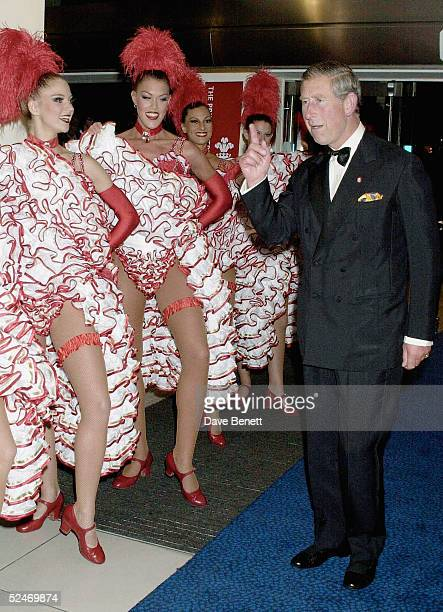 Prince Charles meets Can Can dancers at the premiere of 'Moulin Rouge' in Leicester Square on September 3 2001 in London