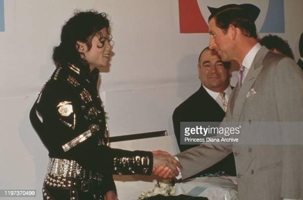 Prince Charles meets singer Michael Jackson backstage at Wembley Stadium in London, before a concert by Jackson in aid of the Prince's Trust charity,...