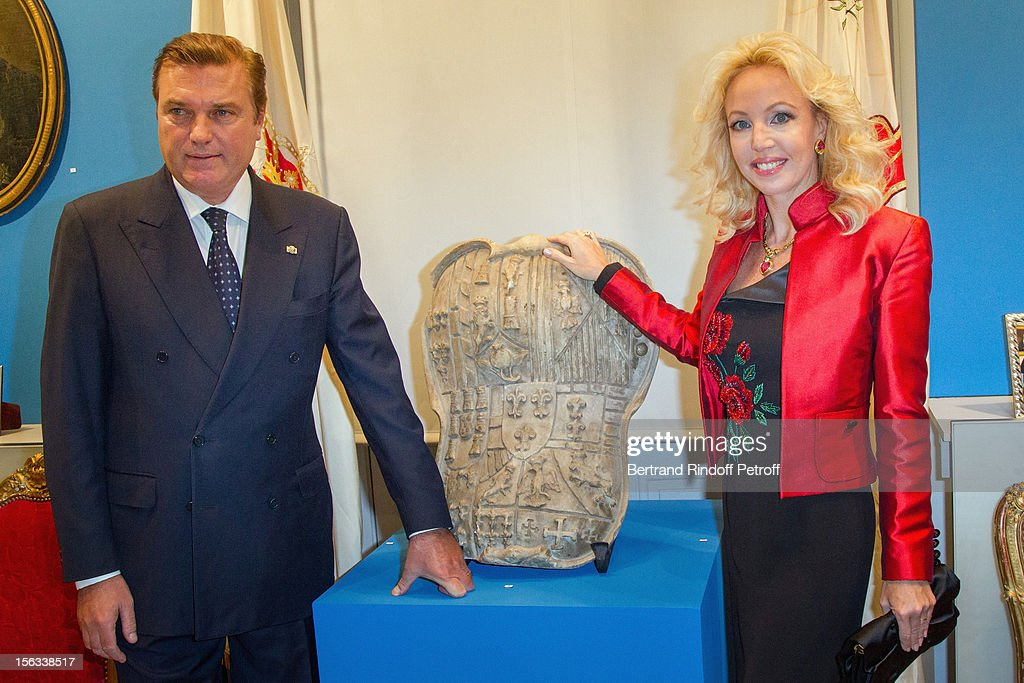 Prince Charles of Bourbon-Two Sicilies and his wife Princess Camilla of Bourbon-Two Sicilies pose by a shield of their Royal House as they attend the Royal House of Bourbon-Two Sicilies Exhibition on November 13, 2012 in Paris, France.