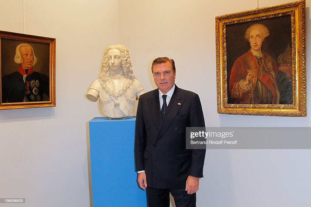 Prince Charles of Bourbon-Two Sicilies poses by a bust of his ancestor King Charles of Bourbon, during the Royal House of Bourbon-Two Sicilies Exhibition on November 13, 2012 in Paris, France.