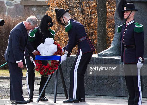 Prince Charles of Britain lays a wreath at the National Monument in Oslo on March 20 2012 Prince Charles and his wife Camilla kick off a Scandinavian...