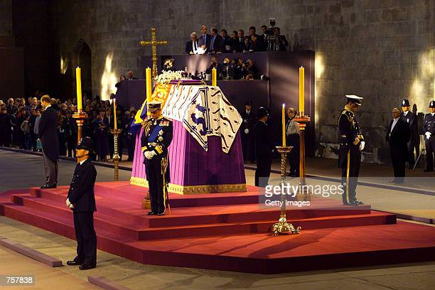 Prince Charles of Britain stands in vigil at the coffin of his grandmother the Queen Mother as it lies in state April 8 2002 in Westminster Hall...