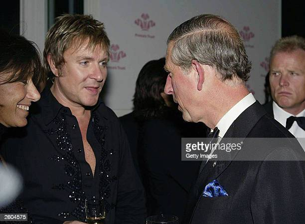 Prince Charles of Great Britain speaks with Simon Le Bon from the band Duran Duran at the after party for the 'Fashion Rocks' concert and fashion...
