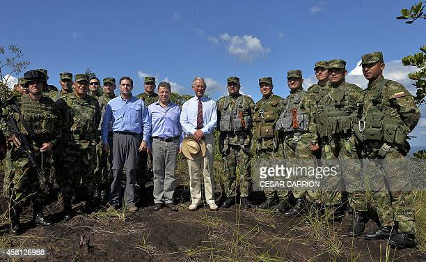 Prince Charles of Wales and Colombian President Juan Manuel Santos pose with soldiers as they visit the National Park of Chiribiquete in the...
