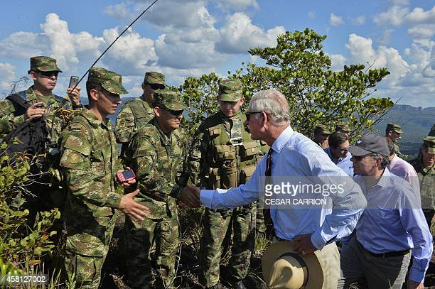 Prince Charles of Wales and Colombian President Juan Manuel Santos shake hands with soldiers as they visit the National Park of Chiribiquete in the...