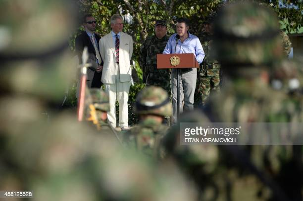 Prince Charles of Wales listens to Colombian President Juan Manuel Santos delivering a speech to his troops at a military base in La Macarena Meta...
