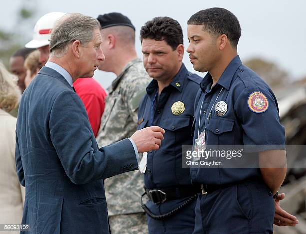 Prince Charles of Wales talks with New Orleans firefighters Autrey Plaisance and Kevin Harrel on a tour to survey the damage to the Lower Ninth Ward...