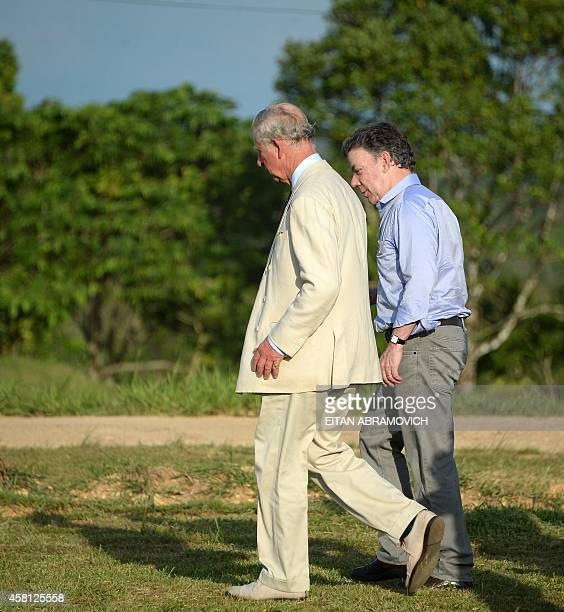 Prince Charles of Wales walks with Colombian President Juan Manuel Santos at a military base in La Macarena, Meta department, Colombia,on October 30,...