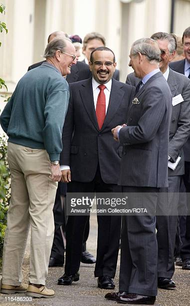 Prince Charles on a visit to Poundbury in Dorset with His Highness the Crown Prince of Bahrain meet a resident of the village former Commander Bill...