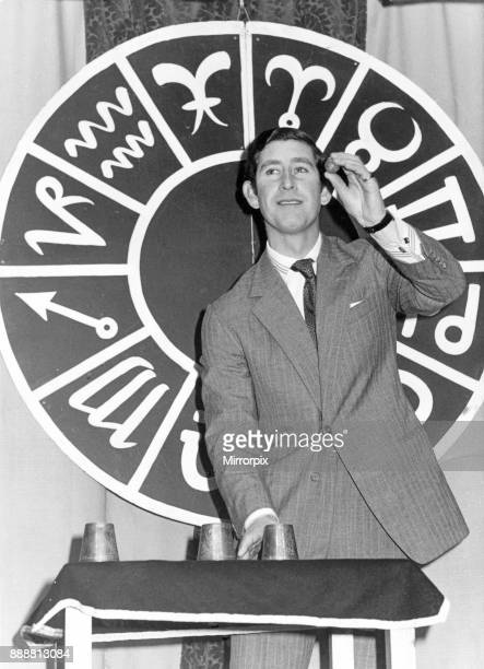 Prince Charles performs his first conjuring trick in public to gain his membership to the Magic Circle It was the traditional buskers cup and ball...
