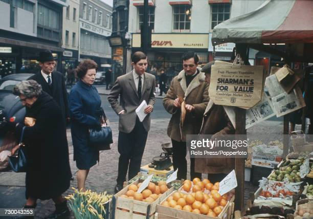 Prince Charles pictured buying fruit at a market stall in Cambridge whilst on a shopping expedition during filming of the television documentary...
