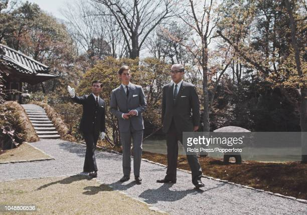 Prince Charles pictured with guides as he is shown around a garden and temple complex during a tour of Japan in April 1970