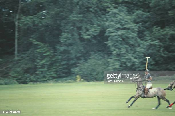 Prince Charles playing polo for the 'Diables Blues' team at Cowdray Park, West Sussex, August 1985.