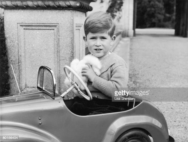 Prince Charles plays in a miniature car in the grounds of Balmoral Castle Scotland September 1952