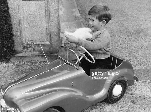 Prince Charles plays in a miniature car in the grounds of Balmoral Castle in Scotland September 1952