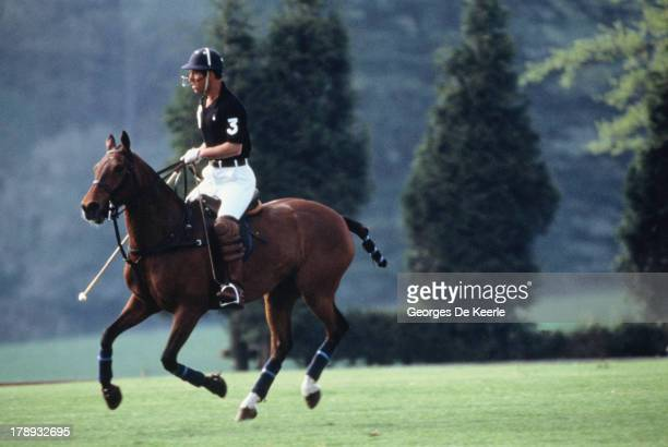 Prince Charles plays polo during the Polo Season Opening at Cirencester Park Polo Club on May 8 1989 in Cirencester England