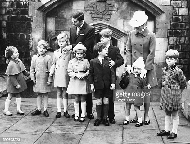 Prince Charles Prince Andrew and Princess Anne arranging a group of Royal grandchildren for a portrait Lady Sarah ArmstrongJones James Ogilvy the...