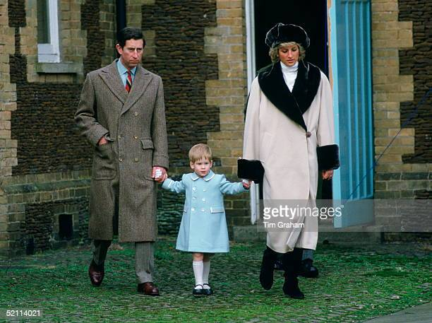 Prince Charles, Prince Harry And Princess Diana Holding Hands As They Arrive For A Photocall At Sandringham. She Is Wearing Cashmere And Wool Coat...