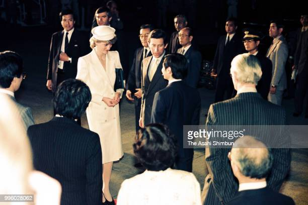 Prince Charles, Prince of Wakes and Princess Diana, Princess of Wales are welcomed by Prince Naruhito on arrival at the Osaka International Airport...