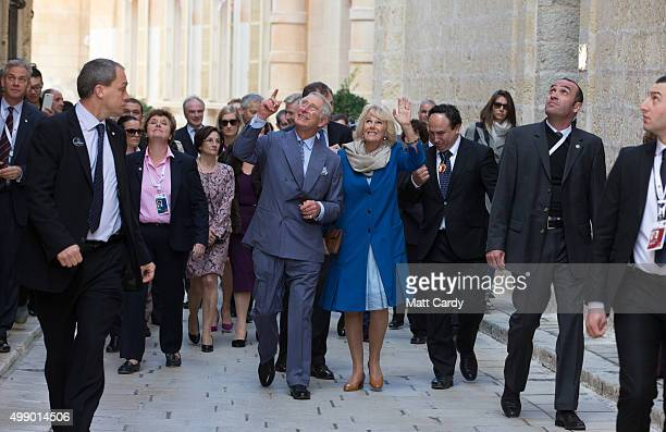 Prince Charles Prince of Wales accompanied by Camilla Duchess take a walking tour of the old town of Mdina in central Malta on November 28 2015 near...