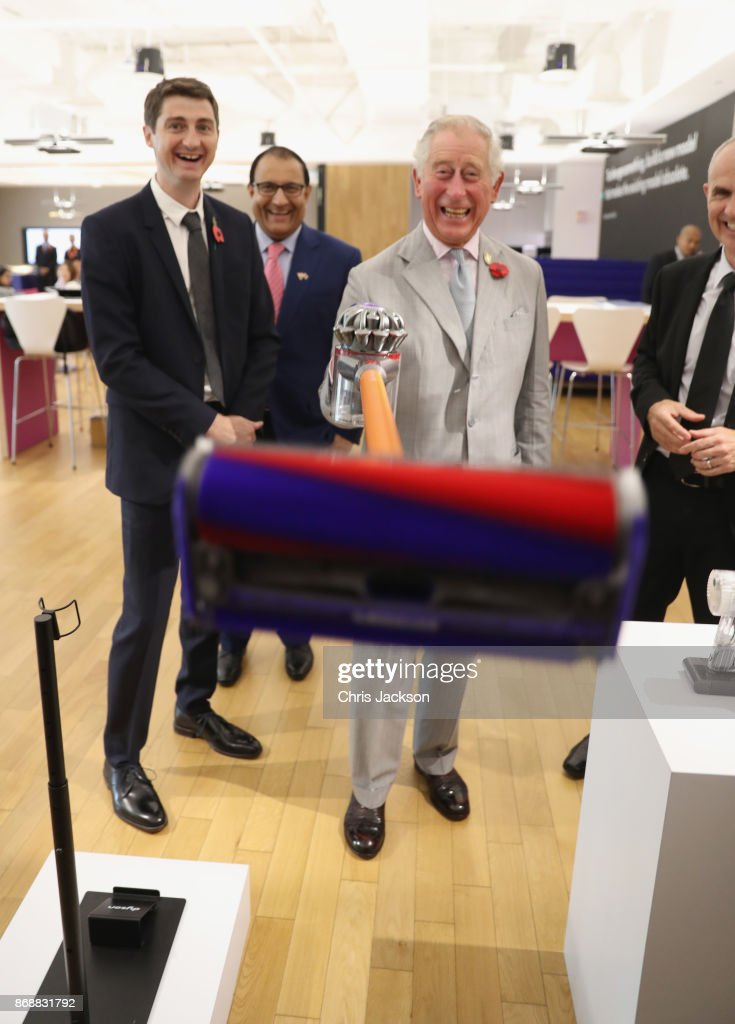Prince Charles, Prince of Wales, accompanied by Dyson's Director of Global Engineering Scott Maguire (L), demonstrates a new Dyson V8 Absolute vacuum cleaner on a photographer during a tour of the Dyson Technology Centre on November 1, 2017 in Singapore. Prince Charles, Prince of Wales and Camilla, Duchess of Cornwall are on a tour of Singapore, Malaysia, Brunei and India
