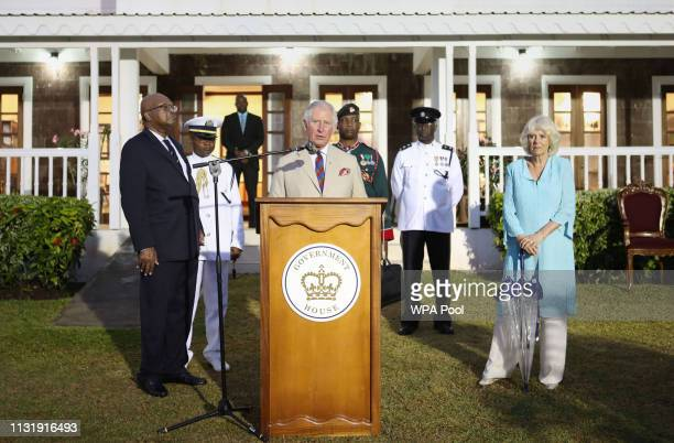 Prince Charles Prince of Wales accompanies by Camilla Duchess of Cornwall and GovernorGeneral of Saint Kitts and Nevis Tapley Seaton speaks during...