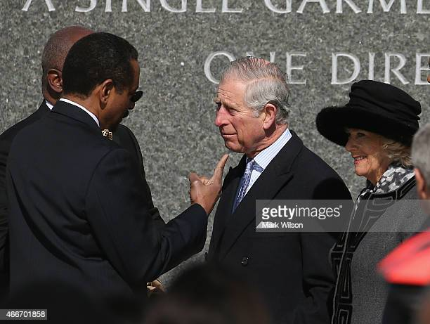 Prince Charles Prince of Wales and and his wife Camilla Duchess of Cornwall talk with Ed Jackson Jr executive architect during a visit the Martin...
