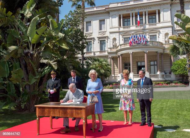 Prince Charles Prince of Wales and Camilla Duchess of Cornwal sign a book of condolence as Mr Christian Estrosi Mayor of Nice and wife Laura Tenoudji...