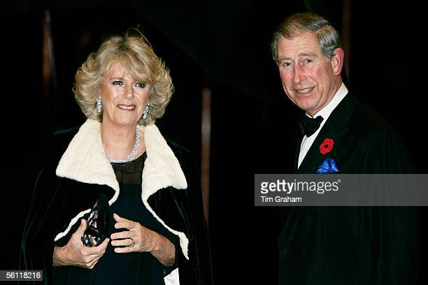Prince Charles Prince of Wales and Camilla Duchess of Cornwall wearing a dress by fashion designers Robinson Valentine with a velvet cape attend a...