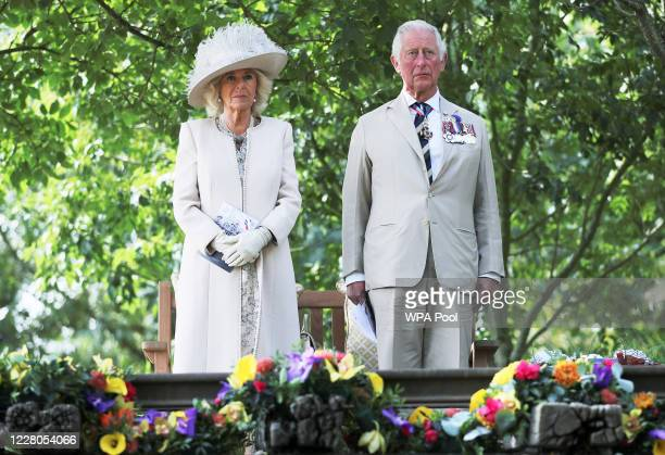 Prince Charles Prince of Wales and Camilla Duchess of Cornwall observe a minutes silence during the VJ Day National Remembrance event held at the...
