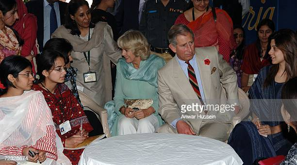 Prince Charles Prince of Wales and Camilla Duchess of Cornwall wearing a traditional Shalwar Kameez chat to students at the all female Fatima Jinnah...
