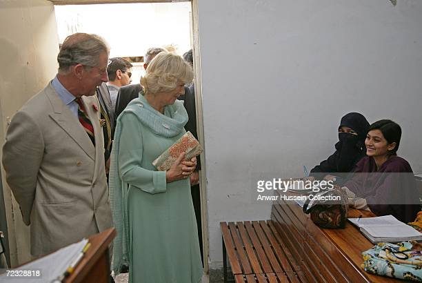 Prince Charles Prince of Wales and Camilla Duchess of Cornwall wearing a traditional Shalwar Kameez visit an Islamic study class at the all female...