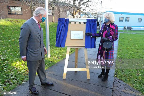Prince Charles, Prince of Wales and Camilla, Duchess of Cornwall unveiling a plaque to commemorate their visit to Gloucestershire Vaccination Centre...