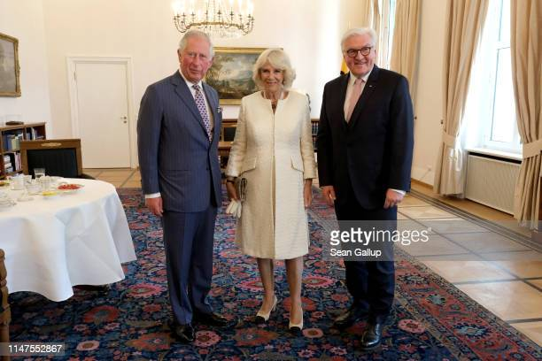 Prince Charles Prince of Wales and Camilla Duchess of Cornwall and German President FrankWalter Steinmeier pose for pictures at Castle Bellevue on...