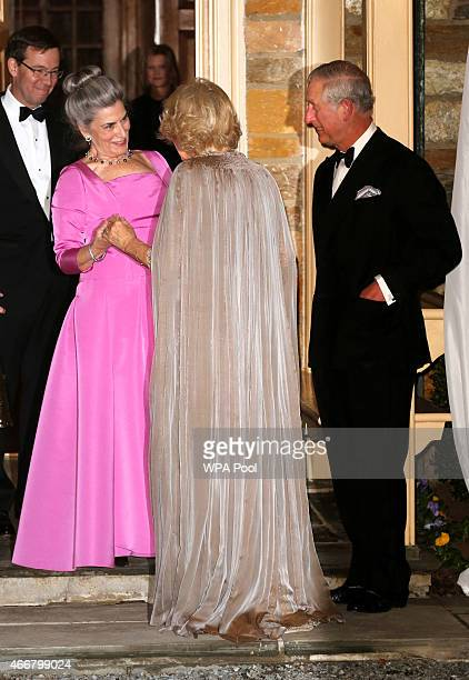 Prince Charles Prince of Wales and Camilla Duchess of Cornwall are received by Barbie Albritton Robert Albritton and Dr Elena Albritton as they...