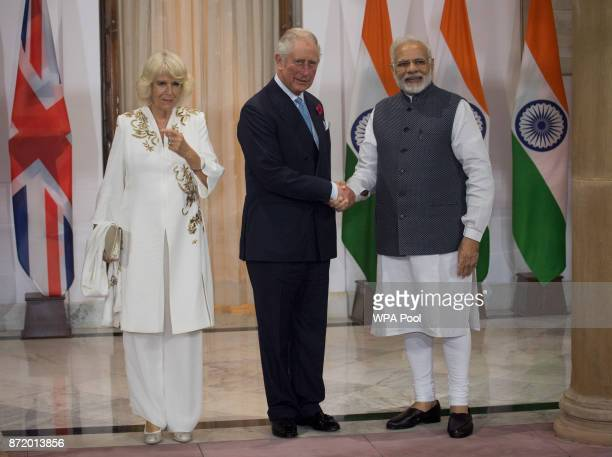 Prince Charles Prince of Wales and Camilla Duchess of Cornwall are greeted by Mr Narendra Modi Prime Minister of India at Hyderabad House during a...