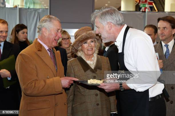 Prince Charles, Prince of Wales ( and Camilla, Duchess of Cornwall are presented with a plate of Davidstow cheese as they attend the Prince's...