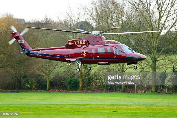 Prince Charles Prince of Wales and Camilla Duchess of Cornwall arrive in a Sikorsky Helicopter for a visit to The Bell pub during a day of...