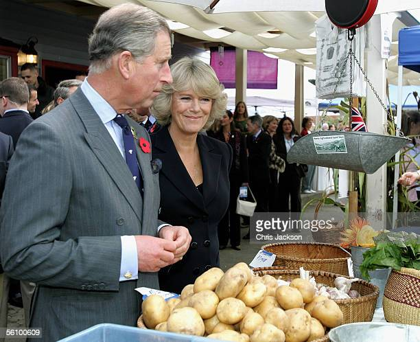 Prince Charles Prince of Wales and Camilla Duchess of Cornwall examine organic potatoes as they tour the West Marin Farmer's Market November 5 2005...