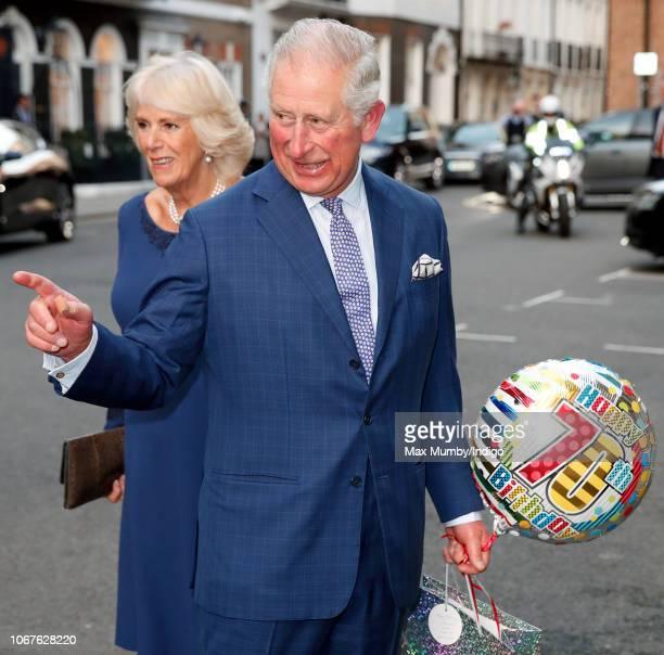 Prince Charles Prince of Wales and Camilla Duchess of Cornwall attend an Age UK Tea celebrating 70 inspirational people marking their 70th birthday...