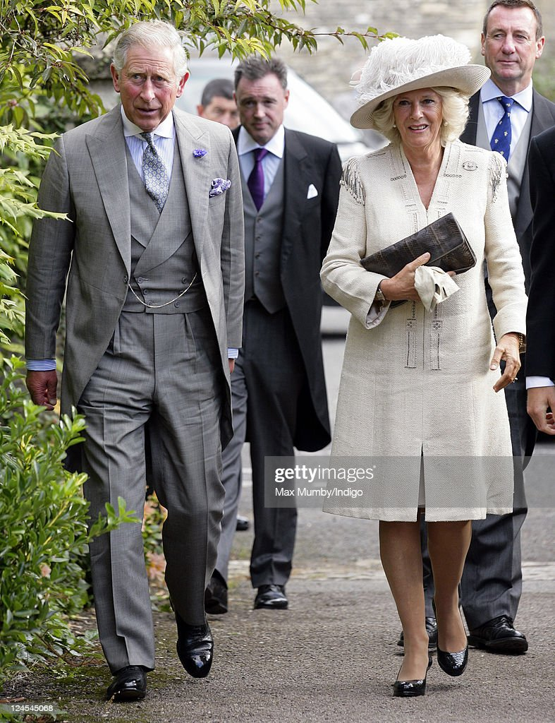 Prince Charles, Prince of Wales and Camilla, Duchess of Cornwall attend the wedding of Ben Elliot and Mary-Clare Winwood at the church of St. Peter and St. Paul, Northleach on September 10, 2011 in Cheltenham, England.