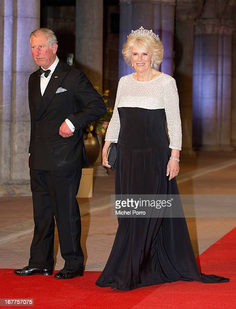 Prince Charles Prince of Wales and Camilla Duchess of Cornwall attend a dinner hosted by Queen Beatrix of The Netherlands ahead of her abdication at...