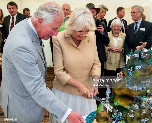 Prince Charles Prince of Wales and Camilla Duchess of Cornwall cut a birthday cake to celebrate the 70th anniversary of the National Parks and Access...