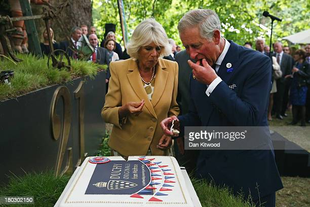 Prince Charles Prince of Wales and Camilla Duchess of Cornwall cut a cake to celebrate the 21st anniversary of Duchy originals products at Clarence...