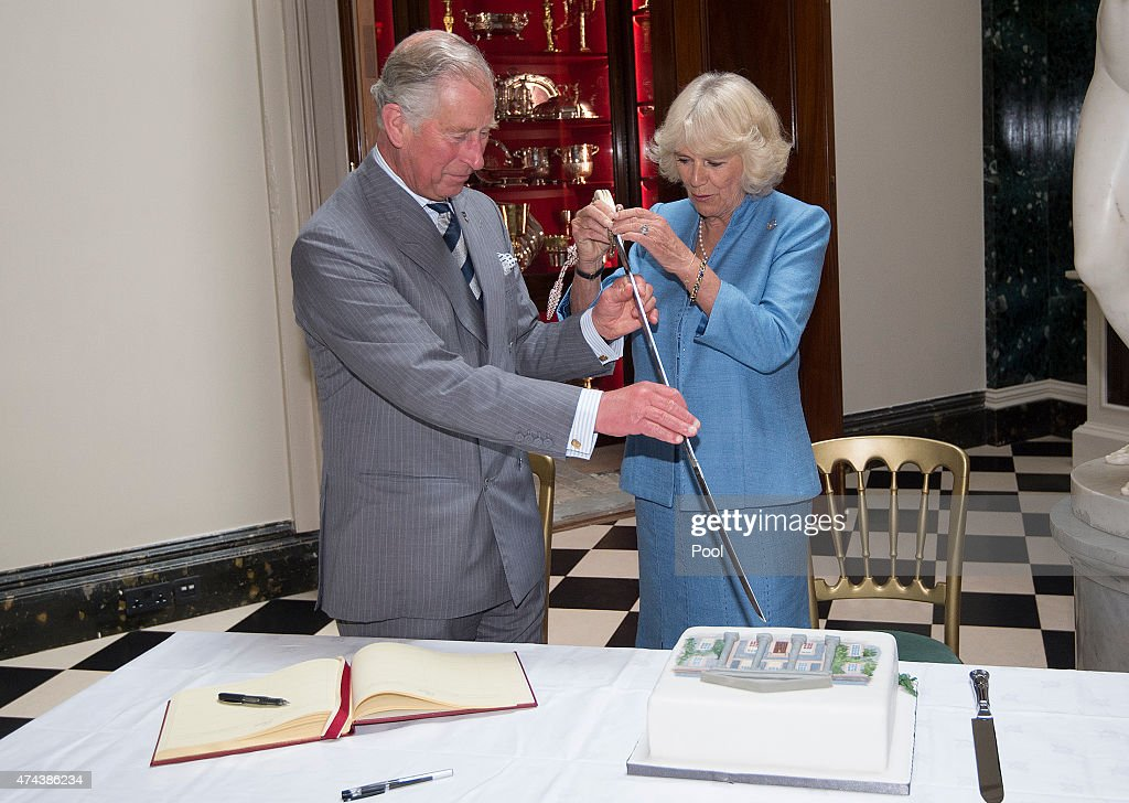 Prince Charles, Prince of Wales and Camilla, Duchess of Cornwall cut a cake with the help of Mr David Lindsay, HM Lord-Lieutenant of County Down during their visit to Mount Stewart House and Garden on May 22, 2015 in Newtownards, Northern Ireland. Prince Charles, Prince of Wales and Camilla, Duchess of Cornwall visited Mount Stewart House and Gardens and Northern Ireland's oldest peace and reconciliation centre Corrymeela on the final day of their visit of Ireland.