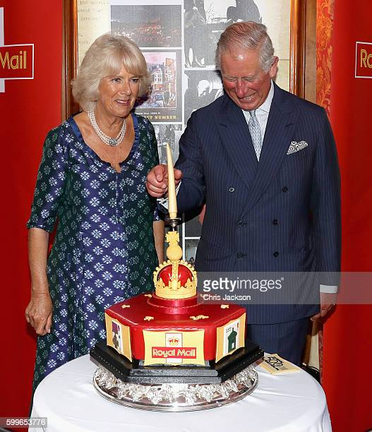 Prince Charles Prince of Wales and Camilla Duchess of Cornwall cut into a celebratory Royal Mail 500 Cake as they attend a reception to mark the...